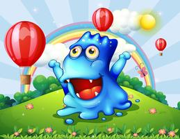 A happy blue monster at the hilltop with the floating balloons vector