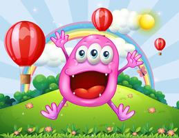 A hilltop with a very happy pink monster jumping