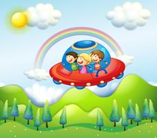 Three kids riding in the spaceship