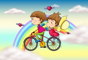 Lovers riding in a bike near the rainbow