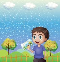 Ein glückliches Kind, das ein Bild mit einem Regenbogen hält