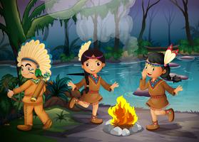 En skog med tre unga indianer