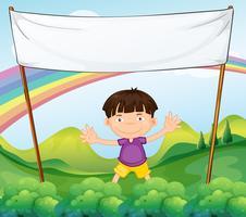 Um banner vazio acima de um garotinho