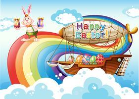 Una feliz plantilla de Pascua con huevos y un conejo cerca del arco iris
