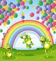 Three frogs under the floating balloons near the rainbow