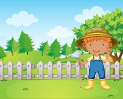 A boy holding a rake