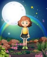 Una ragazza in piedi all'aperto sotto il luminoso fullmoon