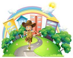 A boy running along the street