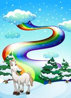 A horse in a snowy area and a rainbow in the sky