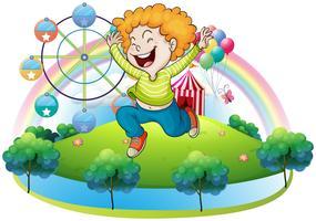 Un bambino felice in un'isola con un carnevale