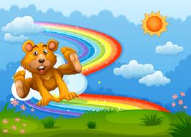A sky with a bear playing near the rainbow