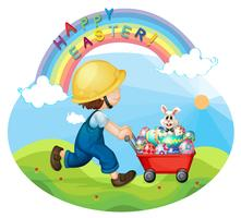 A boy with a helmet pushing the eggs and the bunny