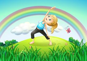 A girl stretching at the top of the hill with a rainbow