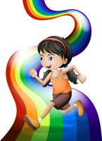 A rainbow with a young woman running
