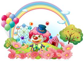 Un payaso en el jardín con un carnaval al fondo.