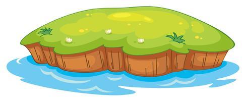 um gramado e água