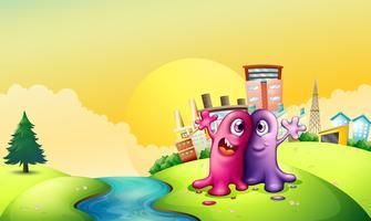 Dos monstruos en la orilla del río cerca de las altas fábricas.