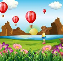 A girl watching the floating balloons
