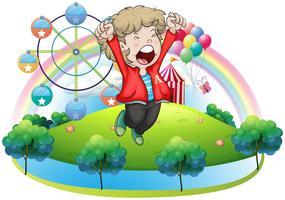 Um menino feliz no carnaval