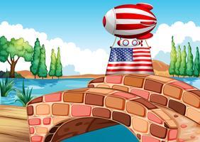 Een ballon en de vlag van de Verenigde Staten boven de brug