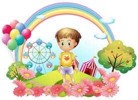 A young boy at the hill with a garden and a carnival vector