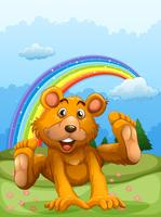 A happy bear playing with a rainbow at the back