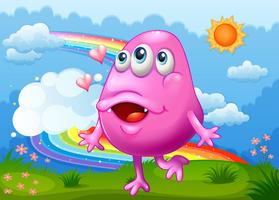 A happy pink monster dancing at the hilltop with a rainbow in the sky