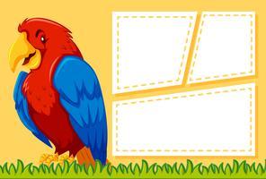 Un pappagallo su una nota vuota