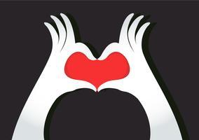 les mains font un symbole du coeur