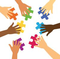 many hands holding colorful puzzle pieces