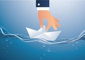 grande mano che tiene il vettore di barca di carta, illustrazione di concetto di affari