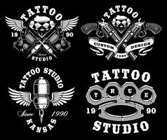 Set of monochrome tattoo emblems on dark background