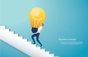 businessman carring light bulb climbing stairs to success