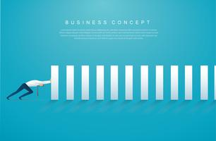 businessman stopping the domino effect. business concept