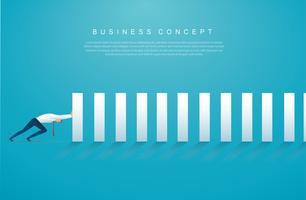 homme d'affaires stoppant l'effet domino. concept d'entreprise