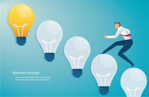 running businessman on light bulb idea concept