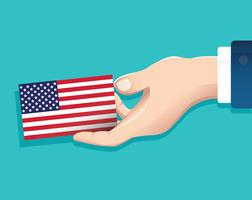 hand holding the usa flag card with blue background