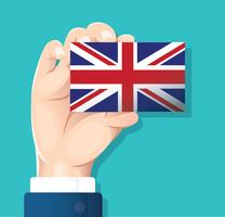 hand holding England flag card with blue background