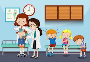 Doctors helping injured children