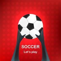 Main tenir le ballon sur un fond rouge abstrait avec un espace texte.