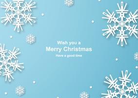 A decoração do Natal no fundo azul no papel cortou e craft com floco de neve.