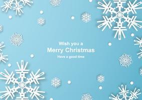Kerstdecoratie op blauwe achtergrond in papier knippen en ambacht met sneeuwvlok.