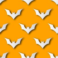 Seamless Halloween bat paper art pattern background. Orange color for happy Halloween day decorating card and gift wrapping concept. Cute graphic design