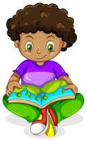 En svartafrikansk pojke läsning bok