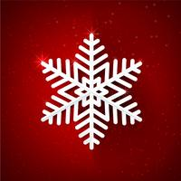 Snow flake with glittering over dark red background 001