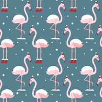 Flamingo in xmas hat seamless pattern on blue background. Exotic New Year background. Christmas design for fabric, wallpaper, textile and decor.