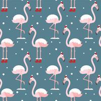 Flamingo im nahtlosen Muster des Weihnachtshutes auf blauem Hintergrund. Exotischer Hintergrund des neuen Jahres. Weihnachtsdesign für Stoff, Tapete, Textil und Dekor.