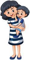 Mor bär liten pojke