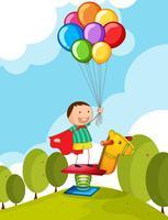 Liten pojke med färgglada ballonger i parken