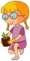 Kleines Mädchen und Topfpflanze